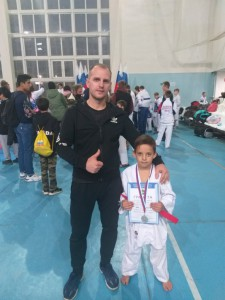 Евгений Александрович со своим юным спортсменом